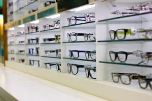 Picking eyeglasses from a frame wall