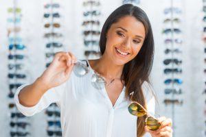 Woman looking at multiple pairs of eyewear